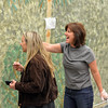 Judy Witt, right, praises the gorilla Tess LeBlanc is painting on a mural for Broomfield High School's Just After Midnight after prom event in the JAM Shed at Broomfield High on Saturday.<br /> January 26, 2013<br /> staff photo/ David R. Jennings