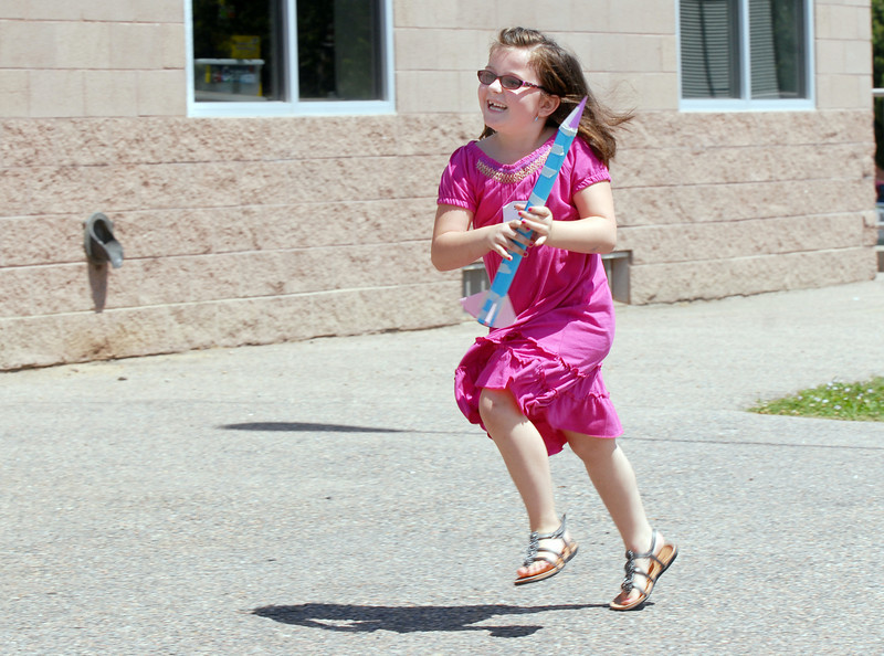 Second grader Sydnee Fisbeck runs with the rocket she launched during class on the first day of the STEM (science, technology, engineering and math) lab school for Adams 12 Five Star School District in Northglenn on Wednesday.<br /> August 18, 2010<br /> staff photo/David R. Jennings