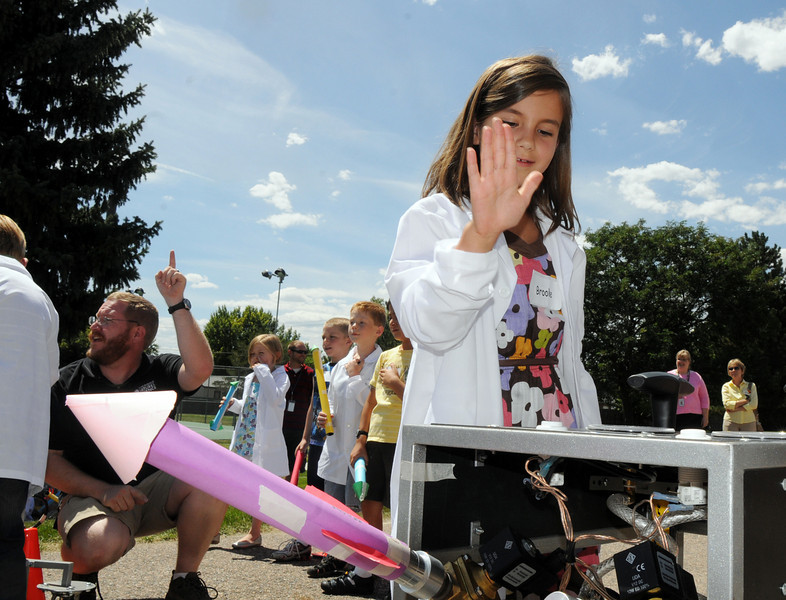 Second grader Brooke Tellinger gets ready to launch her rocket using compressed air during class on the first day of the STEM (science, technology, engineering and math) lab school for Adams 12 Five Star School District in Northglenn on Wednesday.<br /> August 18, 2010<br /> staff photo/David R. Jennings