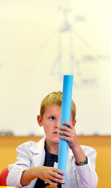 First grader Zachery Szabo works on building his rocket during class on the first day of the STEM (science, technology, engineering and math) lab school for Adams 12 Five Star School District in Northglenn on Wednesday.August 18, 2010<br /> staff photo/David R. Jennings