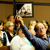 Robert Marcum, father of Jennifer Marcum, holds a photo of Leann Emry, a victim of Scott Kimball, while Howard Emry, father of Leann Emry, reads a statement to the court during a hearing at the Boulder County Justice Center in Boulder Colorado October 8, 2009.  Kimball has been linked to four suspected murders, including that of his uncle and his ex-wife's daughter, was charged Tuesday with two counts of second-degree murder. CAMERA/Mark Leffingwell