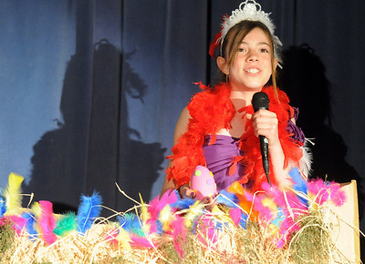 """Mayzie LaBird portrayed by Simone Borelli, sings while """"sitting"""" on an egg during Thursday's performance of Seussical by the Coyote Ridge Elementary School drama club. April 15, 2010 Staff photo/David R. Jennings"""