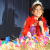 "Mayzie LaBird portrayed by Simone Borelli, sings while ""sitting"" on an egg during Thursday's performance of Seussical by the Coyote Ridge Elementary School drama club.<br /> April 15, 2010<br /> Staff photo/David R. Jennings"