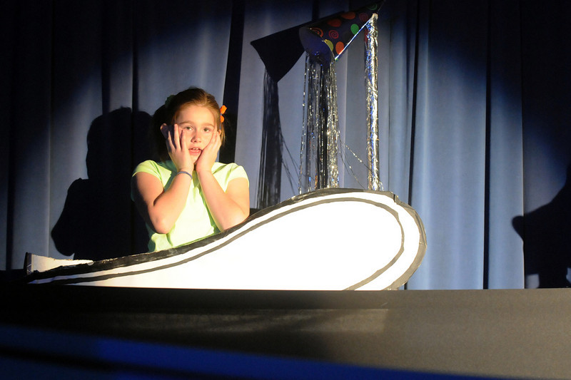 Emma Wacasey as Jojo the Who, sits in a bathtub trying to imagine a bigger world during the Thursday performance of Seussical by the Coyote Ridge Elementary School drama club.<br /> <br /> April 15, 2010<br /> Staff photo/David R. Jennings