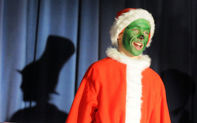 Grey Tonelli, playing the Grinch, sings, with the shadow of the Cat in the Cat behind him, during the Thursday performance of Seussical by the Coyote Ridge Elementary School drama club. April 15, 2010 Staff photo/David R. Jennings