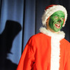 Grey Tonelli, playing the Grinch, sings, with the shadow of the Cat in the Cat behind him, during the Thursday performance of Seussical by the Coyote Ridge Elementary School drama club.<br /> April 15, 2010<br /> Staff photo/David R. Jennings