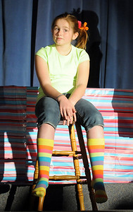 Jojo played by Emma Wacasey sits on a stool after getting in trouble for being different in Whoville during Thursday's performance of Seussical by the Coyote Ridge Elementary School drama club.  April 15, 2010 Staff photo/David R. Jennings
