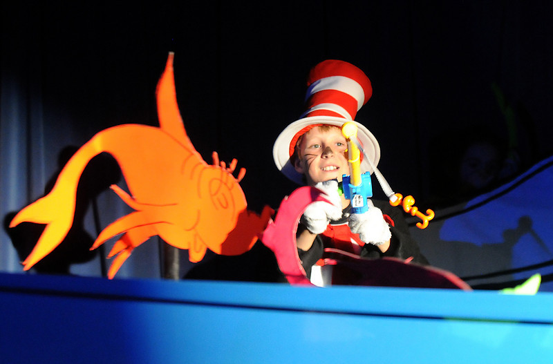 Kevin Ness, as the Cat in the Hat, fishes in a bathtub during Thursday's performance of Seussical by the Coyote Ridge Elementary School drama club.<br /> April 15, 2010<br /> Staff photo/David R. Jennings