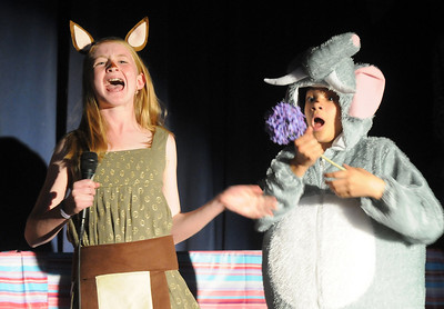 Megan Martin, left, as the Sour Kangaroo, sings as she is about to take the flower with the Whos on it from Haleigh Falconer, portraying Horton the Elephant during the Thursday performance of Seussical by the Coyote Ridge Elementary School's 4th and 5th graders drama club.  April 15, 2010 Staff photo/David R. Jennings