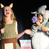 Megan Martin, left, as the Sour Kangaroo, sings as she is about to take the flower with the Whos on it from Haleigh Falconer, portraying Horton the Elephant during the Thursday performance of Seussical by the Coyote Ridge Elementary School's 4th and 5th graders drama club.<br /> <br /> April 15, 2010<br /> Staff photo/David R. Jennings