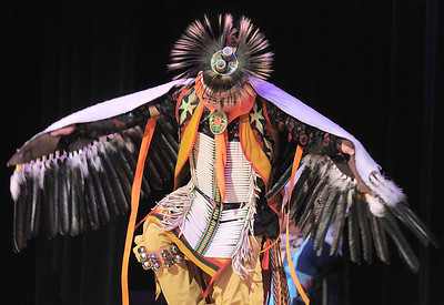 Robert Howell, with the Seven Falls Indian Dancers, performs an eagle dance during  the Children's Library's Wonderful Wednesdays at the Audi the Mamie Doud Eisenhower Public Library. June 8, 2011 staff photo/David R. Jennings