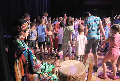 Derek Howell, with the Seven Falls Indian Dancers, drums for the circle and snake dance with the audience participating during  the Children's Library's Wonderful Wednesdays at the Audi the Mamie Doud Eisenhower Public Library. June 8, 2011 staff photo/David R. Jennings