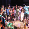Derek Howell, with the Seven Falls Indian Dancers, drums for the circle and snake dance with the audience participating during  the Children's Library's Wonderful Wednesdays at the Audi the Mamie Doud Eisenhower Public Library.<br /> June 8, 2011<br /> staff photo/David R. Jennings