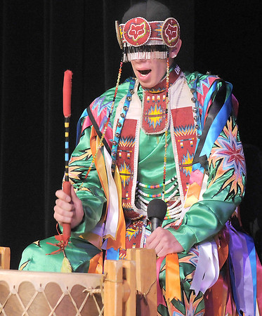 Derek Howell, a Pawnee with the Seven Falls Indian Dancers, drums for the other dancers during  the Children's Library's Wonderful Wednesdays at the Audi the Mamie Doud Eisenhower Public Library.<br /> June 8, 2011<br /> staff photo/David R. Jennings