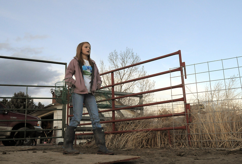 """Shelby Grebenc, 12, walks to the chicken coup area to gather eggs from 130 chickens for her business """"Shelby's Happy Chapped Chicken Butt Farm"""" at her home on 4 acres in Broomfield on Thursday. Grebenc is the youngest person to be certified as an Animal Welfare Approved chicken farm.<br /> For more photos please see  <a href=""""http://www.broomfieldenterprise.com"""">http://www.broomfieldenterprise.com</a><br /> January 19, 2012<br /> staff photo/ David R. Jennings"""