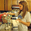 "Shelby Grebenc, 12, places eggs from her 130 chickens into cartons for her business ""Shelby's Happy Chapped Chicken Butt Farm"" at her home on 4 acres in Broomfield on Thursday. Grebenc is the youngest person to be certified as an Animal Welfare Approved chicken farm.<br /> For more photos please see  <a href=""http://www.broomfieldenterprise.com"">http://www.broomfieldenterprise.com</a><br /> January 19, 2012<br /> staff photo/ David R. Jennings"