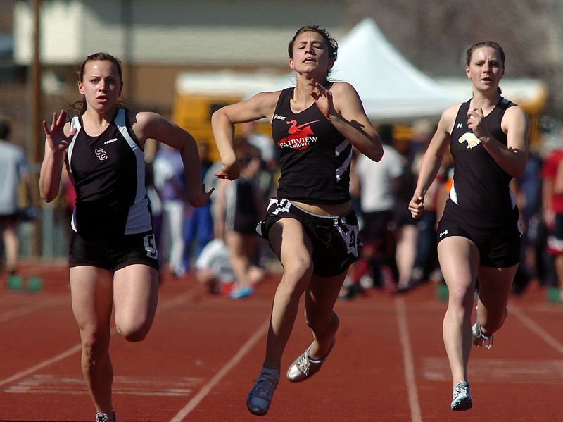 be0402trak10<br /> Fairview's Justine Sherman, center, running in the 100m dash next to Silver Creeks' Jennifer Altemus, left, and Thompson Valley's Lena Wehrung and  during the Broomfield Shoot Out Track Meet at Elizabeth Kennedy Stadium on Friday..<br /> April 1, 2011<br /> staff photo/David R. Jennings