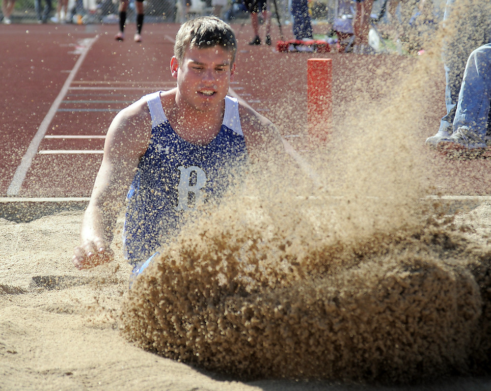 be0402trak13<br /> Broomfeild's Aric Kaiser lands in the sand in the long jump during the Broomfield Shoot Out Track Meet at Elizabeth Kennedy Stadium on Friday..<br /> April 1, 2011<br /> staff photo/David R. Jennings
