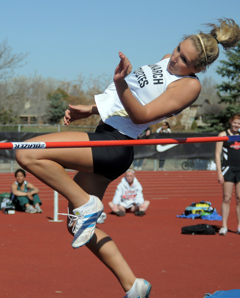 be0402trak12<br /> Monarch's Erin Gumbiner clears the 4 foot 8 inches in the high jump during the Broomfield Shoot Out Track Meet at Elizabeth Kennedy Stadium on Friday..<br /> April 1, 2011<br /> staff photo/David R. Jennings