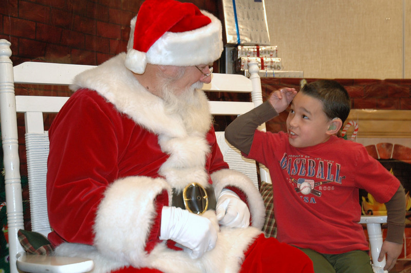 Signing Santa third-grader Matthew Fernandez some holiday cheer at Mountain View Elementary on Tuesday, December 8, 2009. Photo: Dylan Otto Krider