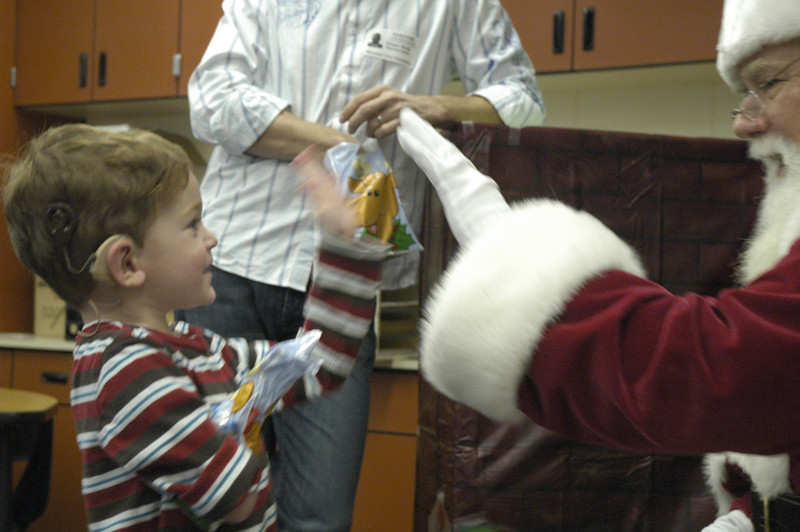Preschooler Evan Burch high-fives Signing Santa  at Mountain View Elementary on Tuesday, December 8, 2009. Photo: Dylan Otto Krider