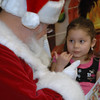 Signing Santa hears what preschooler Melanie Navarrete wants for Christmas at Mountain View Elementary on Tuesday, December 8, 2009. Photo: Dylan Otto Krider
