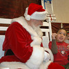 Third-grader Matthew Fernandez signs his Christmas wish list to Signing Santa at Mountain View Elementary on Tuesday, December 8, 2009. Photo: Dylan Otto Krider