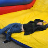 Trevor Cox, 11, laughs after finishing the inflatable obstacle course during the 50th anniversary celebration of Sill-TerHar Motors on Saturday.<br /> May 14, 2010<br /> Staff photo/ David R. Jennings