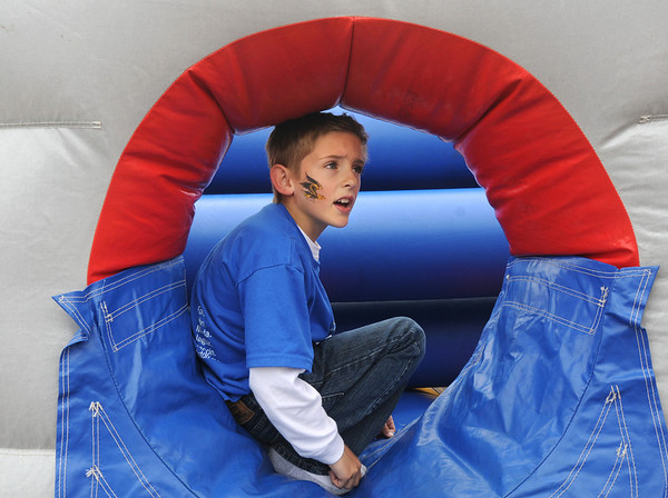Kaleb Smith, 7, waits to go through the inflatable obstacle course during the 50th anniversary celebration of Sill-TerHar Motors on Saturday.<br /> May 14, 2010<br /> Staff photo/ David R. Jennings