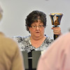 Silver Bells hand bell choir director Mary McIntire plays the G bell with the choir during rehearsal at Holy Comforter church on Thursday.<br /> March 7, 2013<br /> staff photo/ David R. Jennings