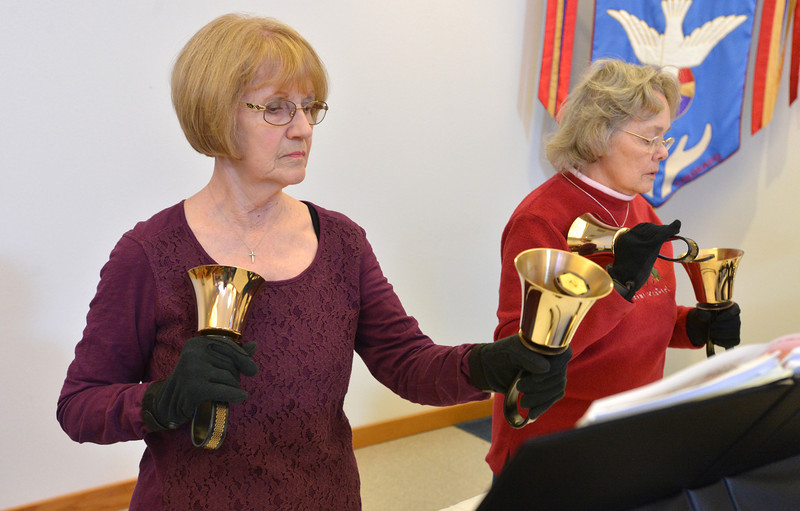 Teddie Davis, left, and Nancy Culbertson play their hand bells during rehearsal of the Silver Bells hand bell choir at Holy Comforter church on Thursday.<br /> March 7, 2013<br /> staff photo/ David R. Jennings
