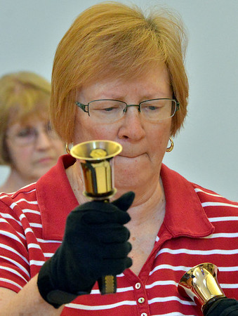 Laurie Goldstein concentrates while playing her bells during rehearsal of the Silver Bells hand bell choir at Holy Comforter church on Thursday.<br /> March 7, 2013<br /> staff photo/ David R. Jennings
