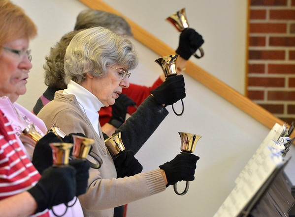 Shirley Mansfield, center, rings her bells during rehearsal of the Silver Bells hand bell choir at Holy Comforter church on Thursday.<br /> March 7, 2013<br /> staff photo/ David R. Jennings