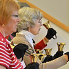 Shirley Mansfield, center, plays her bells during rehearsal of the Silver Bells hand bell choir at Holy Comforter church on Thursday.<br /> March 7, 2013<br /> staff photo/ David R. Jennings