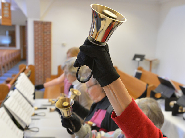Bobbi LaPlaca plays her hand bell during rehearsal of the Silver Bells hand bell choir at Holy Comforter church on Thursday.<br /> March 7, 2013<br /> staff photo/ David R. Jennings