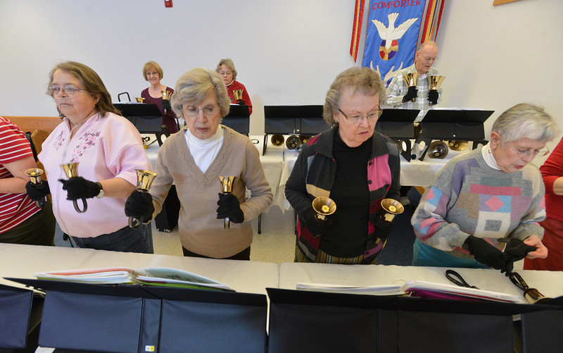 Playing their bells Pattie Trimble, left, Chirley Mansfield, Phyllis Pettay and Maybelle Traut follow the music during rehearsal of the Silver Bells hand bell choir at Holy Comforter church on Thursday.<br /> March 7, 2013<br /> staff photo/ David R. Jennings