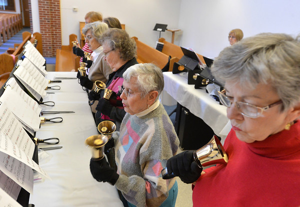 The Silver Bells hand bell choir rehearses at Holy Comforter church on Thursday.<br /> March 7, 2013<br /> staff photo/ David R. Jennings