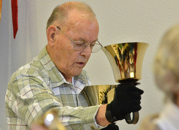 Mike Traut has the task of playing the biggest bells of the choir during rehearsal of the Silver Bells hand bell choir at Holy Comforter church on Thursday.<br /> March 7, 2013<br /> staff photo/ David R. Jennings