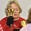 Nancy Culbertson concentrates while playing her bells during rehearsal of the Silver Bells hand bell choir at Holy Comforter church on Thursday.<br /> March 7, 2013<br /> staff photo/ David R. Jennings