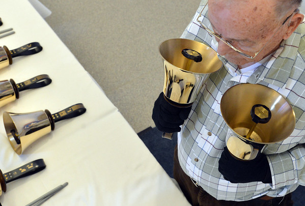 Mike Traut waits to play the heavy bells during rehearsal of the Silver Bells hand bell choir at Holy Comforter church on Thursday.<br /> March 7, 2013<br /> staff photo/ David R. Jennings