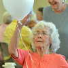 Rosell Wiens laughs while playing with a balloon at the 10th Anniversary celebration of the Silver Sneakers program at the Broomfield Community Center on Friday.<br /> <br /> <br /> July 20, 2012<br /> staff photo/ David R. Jennings