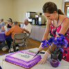 Jenifer Chrisman, Broomfield Community Resources, cuts the cake for celebrants at the 10th Anniversary celebration of the Silver Sneakers program at the Broomfield Community Center on Friday.<br /> <br /> July 20, 2012<br /> staff photo/ David R. Jennings