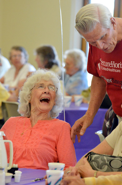 Rosell Wiens laughs with Bob Niehoff at the 10th Anniversary celebration of the Silver Sneakers program at the Broomfield Community Center on Friday.<br /> <br /> <br /> July 20, 2012<br /> staff photo/ David R. Jennings