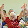Ilene Niehoff stretches with fellow celebrants at the 10th Anniversary celebration of the Silver Sneakers program at the Broomfield Community Center on Friday.<br /> <br /> July 20, 2012<br /> staff photo/ David R. Jennings