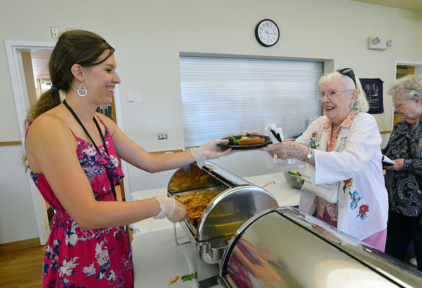 Jenifer Chrisman, left, community resources, severs Bridget Billette her meal at the 10th Anniversary celebration of the Silver Sneakers program at the Broomfield Community Center on Friday.<br /> <br /> July 20, 2012<br /> staff photo/ David R. Jennings
