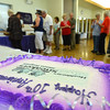 A celebratory cake on display as seniors wait in line for their food at the 10th Anniversary celebration of the Silver Sneakers program at the Broomfield Community Center on Friday.<br /> <br /> July 20, 2012<br /> staff photo/ David R. Jennings