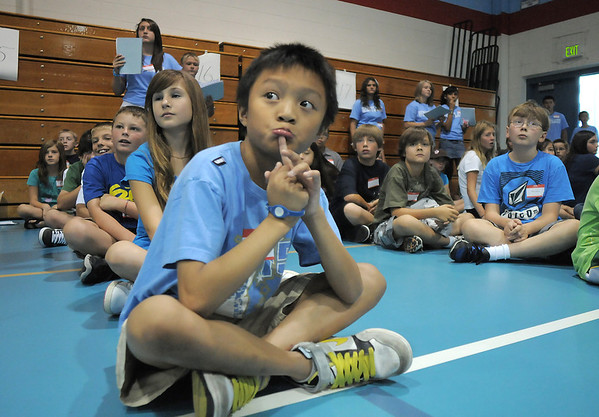 Kevin Truong sits in line before going to classrooms with 8th graders for games aimed at getting to know each other in their group during Westlake Middle School's 6th grade orientation on Thursday.<br /> August 11, 2011<br /> staff photo/ David R. Jennings