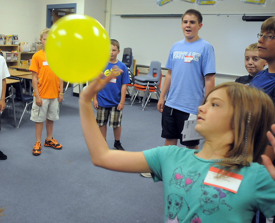 Dione Honre hits a balloon while naming a classmate during Westlake Middle School's 6th grade orientation on Thursday.<br /> August 11, 2011<br /> staff photo/ David R. Jennings