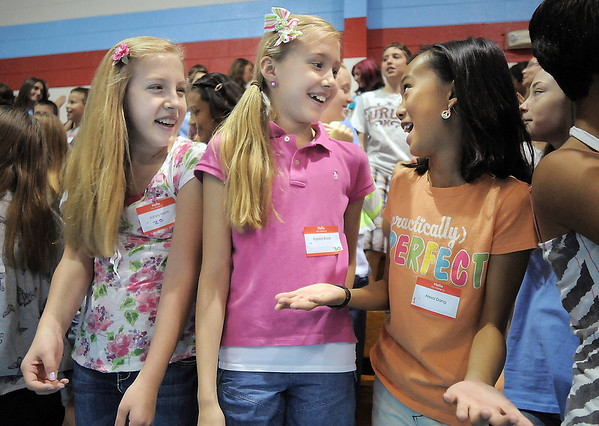 Ashley Merrill, left, Kaylee Brock and Alexa Dang chat with each other  during Westlake Middle School's 6th grade orientation on Thursday.<br /> August 11, 2011<br /> staff photo/ David R. Jennings