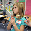 Dione Horne holds straws with fellow 6th graders and their 8th grade leaders as a getting aquainted game during Westlake Middle School's 6th grade orientation on Thursday.<br /> August 11, 2011<br /> staff photo/ David R. Jennings
